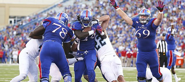 Kansas running back Taylor Martin (24) gets across the goal line past Rhode Island linebacker Justin Hogan (22) during the second quarter on Saturday, Sept. 3, 2016 at Memorial Stadium.
