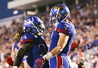 Kansas running back Taylor Martin (24) and Kansas wide receiver Tyler Patrick (4) celebrate Patrick's touchdown reception during the third quarter on Saturday, Sept. 3, 2016 at Memorial Stadium.