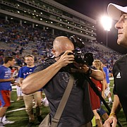 Kansas head coach David Beaty runs off the field with his first win after beating Rhode Island 55-6 on Saturday, Sept. 3, 2016 at Memorial Stadium.