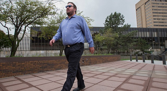 Former Lawrence Mayor Jeremy Farmer enters the Frank Carlson Federal Building on Thursday, Sept. 8, 2016, in Topeka. Farmer was appearing on a charge of embezzling funds during his time as the executive director of Just Food.
