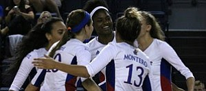 The fourth-ranked KU volleyball team celebrates a point Sept. 9, 2016, in Omaha, Nebraska, during its four-set victory over Chattanooga in the Bluejay Invitational.