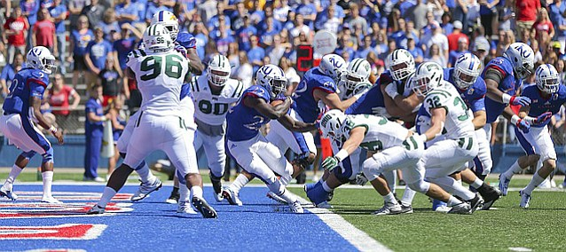 Kansas running back Ke'aun Kinner (22) is stopped in the end zone by Ohio linebacker Austin Clack (36) for a safety during the first quarter on Saturday, Sept. 10, 2016 at Memorial Stadium.