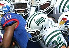 Kansas running back Khalil Herbert (10) is wrapped up by a pack of Ohio defenders during the second quarter on Saturday, Sept. 10, 2016 at Memorial Stadium.