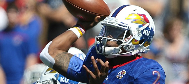 Kansas quarterback Montell Cozart (2) throws during the second quarter on Saturday, Sept. 10, 2016 at Memorial Stadium.