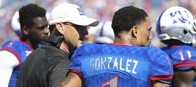 Kansas head coach David Beaty gives a pat on the back to Kansas wide receiver LaQuvionte Gonzalez (1) after Gonzalez fumbled a punt during the second quarter on Saturday, Sept. 10, 2016 at Memorial Stadium.
