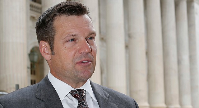 Kansas Secretary of State Kris Kobach responds to questions outside the 10th U.S. Circuit Court of Appeals after delivering an argument in the legal fight over how the state of Kansas enforces its proof-of-citizenship requirement for voters who register at motor vehicle offices on Tuesday, Aug. 23, 2016 in Denver. (AP Photo/David Zalubowski)