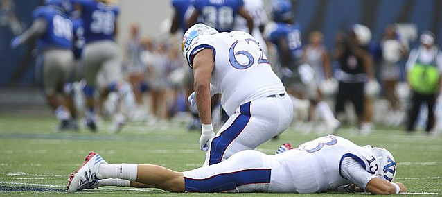 Kansas quarterback Ryan Willis (13) and offensive lineman D'Andre Banks (62) lower their heads in dejection after a Memphis player recovered a Willis fumble running it down the field during the first quarter on Saturday, Sept. 17, 2016 at Liberty Bowl Memorial Stadium in Memphis, Tenn.