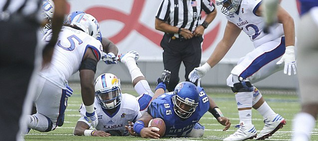 Memphis defensive lineman Michael Edwards (95) recovers a Kansas quarterback Montell Cozart (2) fumble during the second quarter on Saturday, Sept. 17, 2016 at Liberty Bowl Memorial Stadium in Memphis, Tenn.