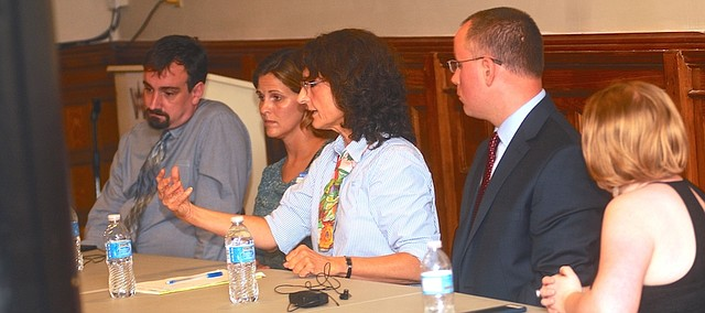 University of Kansas professor Charlene Muehlenhard, center, responds to a question at a panel discussion on sexual violence Wednesday, Sept. 21, 2016, at the Watkins Museum of History. Joining her on the panel were, from left, KU law professor Corey Rayburn Yung, Jen Brockman, director of the KU Sexual Assault Prevention and Education Center, Assistant District Attorney Mark Simpson, and Rachel Gadd-Nelson, of the Lawrence Sexual Trauma and Abuse Care Center.