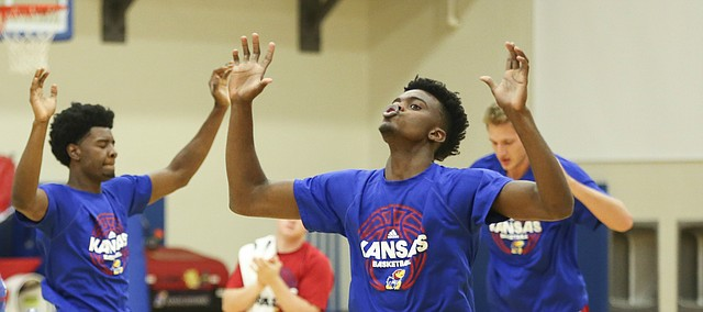 "Kansas players Dwight Coleby, left, Josh Jackson and Lagerald Vick perform ""boxes"" during Boot Camp in the practice gym on Friday, Sept. 23, 2016 just after 6 a.m."