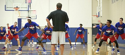 Kansas head coach Bill Self watches as the players rapidly shuffle across the court during Boot Camp in the practice gym on Friday, Sept. 23, 2016 just after 6 a.m.