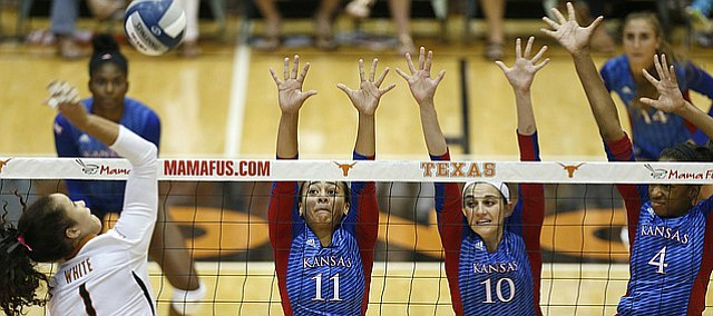 Kansas' Ainise Havil i(11), Tayler Soucie (10) and Jada Burse (4) look to block Texas' Micaya Whit e(1) during a match at Gregory Gym in Austin, Saturday, Sept. 24, 2016.