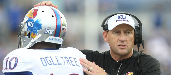 Kansas head coach David Beaty gives a pat to Kansas cornerback Marnez Ogletree (10) as the defense leaves the field following a Memphis touchdown during the second quarter on Saturday, Sept. 17, 2016 at Liberty Bowl Memorial Stadium in Memphis, Tenn.
