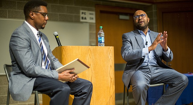 Jabari Asim, right, author and editor-in-chief of The Crisis magazine, answers a question from professor Clarence Lang on Thursday, Sept. 29, 2016 at Budig Hall. Asim presented the fall keynote lecture for the University of Kansas' Common Book program.
