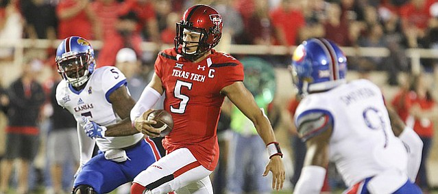 Texas Tech quarterback Patrick Mahomes II (5) runs for a first down past Kansas linebacker Marcquis Roberts (5) during the first quarter on Thursday, Sept. 29, 2016 at Jones AT&T Stadium in Lubbock, Texas.