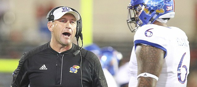 Kansas head coach David Beaty tries to get the attention of an official during the second quarter on Thursday, Sept. 29, 2016 at Jones AT&T Stadium in Lubbock, Texas.