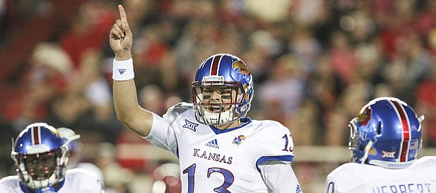 Kansas quarterback Ryan Willis (13) communicates with the Jayhawks' sideline during the second quarter on Thursday, Sept. 29, 2016 at Jones AT&T Stadium in Lubbock, Texas.
