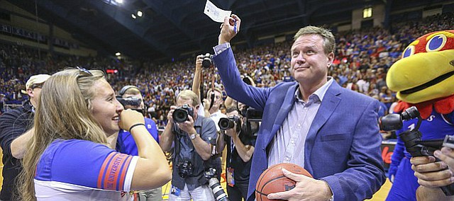 Kansas sophomore Jordan Stiers, Independence, Mo., cries some joyful tears as Bill Self hands over a $10 thousand personal check to her after Brennan Bechard, director of basketball operations, hit a half-court shot for her for the second year in a row during Late Night in the Phog on Saturday, Oct. 1, 2016 at Allen Fieldhouse.