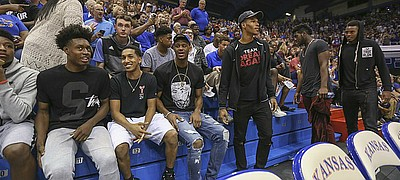 A line of Kansas recruits sit down for Late Night in the Phog on Saturday, Oct. 1, 2016 at Allen Fieldhouse.