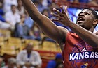 Kansas guard Malik Newman gets in for a bucket past Clay Young during Late Night in the Phog on Saturday, Oct. 1, 2016 at Allen Fieldhouse.