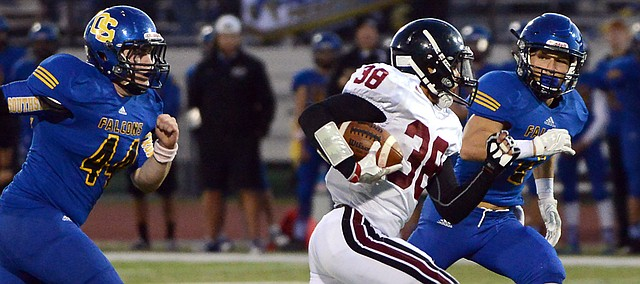 Trey Moore (38) takes off for a big gain the the first half as Lawrence High played Olathe South Friday at ODAC.