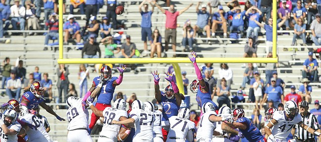 TCU place kicker Brandon Hatfield (27) puts a field goal up over the Kansas defense and through the uprights to give the Horned Frogs the lead late in the fourth quarter on Saturday, Oct. 8, 2016 at Memorial Stadium.