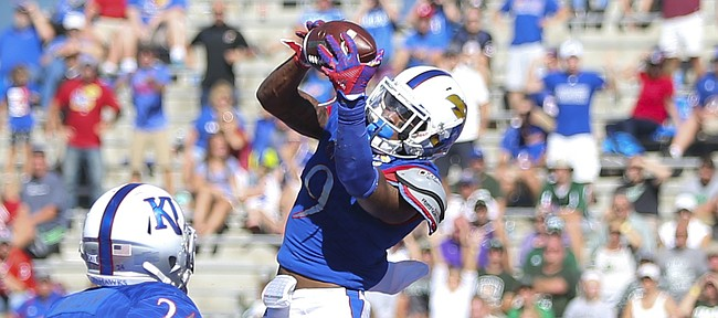 Kansas safety Fish Smithson (9) pulls in an interception in the end zone during the third quarter on Saturday, Sept. 10, 2016 at Memorial Stadium.