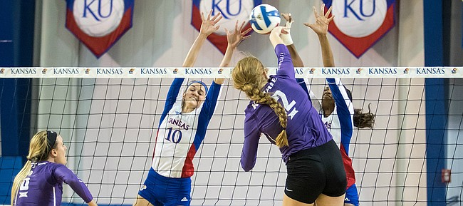 Kansas senior middle blocker Tayler Soucie attempts to block a shot from Kansas State's Macy Flowers on Wednesday, Oct. 12, 2016 at Horejsi Center.