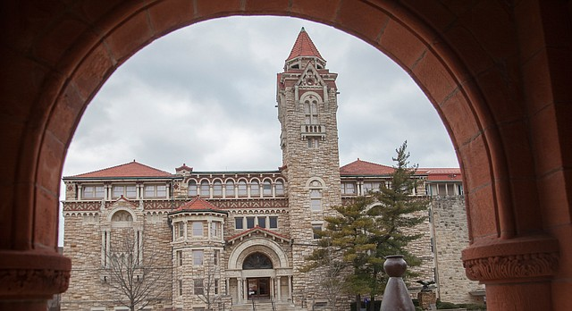 Dyche Hall, home to the University of Kansas Natural History Museum, is framed by an archway at KU's Spooner Hall in this file photo from February 2016.