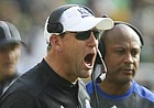 Kansas head coach David Beaty yells at the offense during the second quarter on Saturday, Oct. 15, 2016 at McLane Stadium in Waco, Texas.