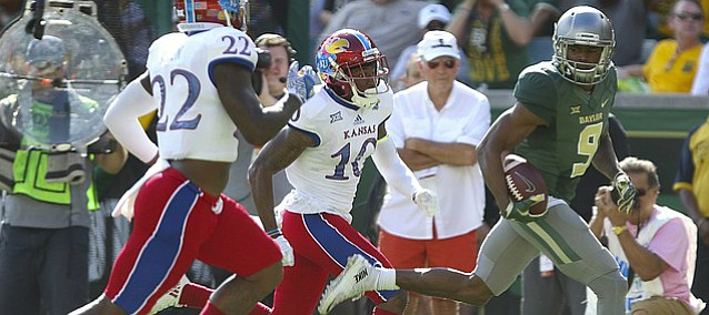 Baylor wide receiver KD Cannon (9) leaves Kansas cornerback Marnez Ogletree (10) and safety Greg Allen (22) behind on a touchdown run during the second quarter on Saturday, Oct. 15, 2016 at McLane Stadium in Waco, Texas.