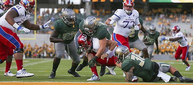 Kansas quarterback Carter Stanley (9) is smothered by the Baylor defense just before the goal line to avoid a safety during the fourth quarter on Saturday, Oct. 15, 2016 at McLane Stadium in Waco, Texas.