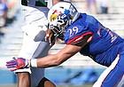Kansas linebacker Joe Dineen Jr. (29) pressures Ohio quarterback Greg Windham (14) during the third quarter on Saturday, Sept. 10, 2016 at Memorial Stadium.