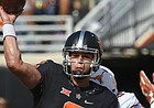 Oklahoma State quarterback Mason Rudolph (2) throws as he is hit by Texas defensive tackle Paul Boyette Jr. (93) in the first quarter of an NCAA college football game in Stillwater, Okla., Saturday, Oct. 1, 2016. (AP Photo/Sue Ogrocki)