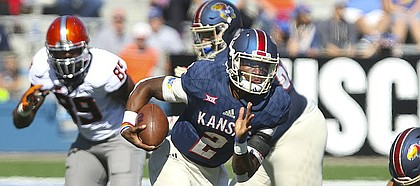 Kansas quarterback Montell Cozart (2) takes off on a run during the second quarter on Saturday, Oct. 22, 2016 at Memorial Stadium.