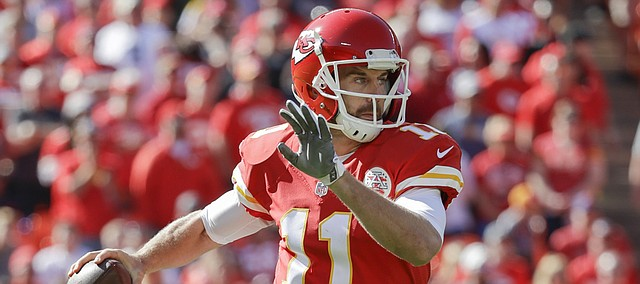 Kansas City Chiefs quarterback Alex Smith (11) looks for a receiver during the first half of an NFL game against the New Orleans Saints in Kansas City, Mo., on Sunday, Oct. 23, 2016.