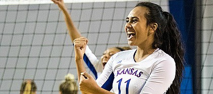 Kansas junior setter Ainise Havili celebrates a point against West Virginia on Thursday, Oct. 20, 2016 at Horejsi Center.