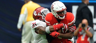 FILE - In this Sept. 3, 2016, file photo, Houston quarterback Greg Ward Jr. (1) is tackled by Oklahoma linebacker Ogbonnia Okoronkwo (31) in the second half of Houston's 33-23 victory in an NCAA college football game, in Houston.