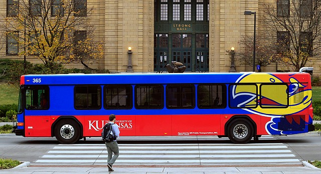 A bus passes in front of Strong Hall, an administrative building, Monday, Nov. 16, 2015 on the University of Kansas campus in Lawrence, Kan.