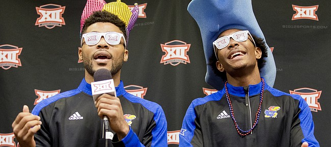 """Kansas guards Frank Mason III and Devonte Graham lip sync the words to """"Let It Burn"""" by Usher, during some down time from interviews in the """"Social Media"""" room as part of Big 12 Media Day on Tuesday, Oct. 25, 2016 at Sprint Center."""