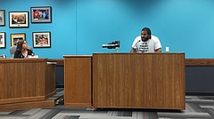 Caleb Stephens, an organizer of the Lawrence chapter of Black Lives Matter, addresses the Lawrence school board, including board member Vanessa Sanburn, at left, during an Oct. 24, 2016 meeting at the district offices, 110 McDonald Drive. Stephens and other BLM allies spoke out against the district's handling of, among other issues, recent allegations against a South Middle School teacher who had reportedly made racist comments during class.