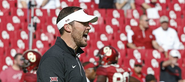 Oklahoma offensive coordinator Lincoln Riley shouts to his players before the start of of an NCAA college football game between Kansas State and Oklahoma in Norman, Okla., Saturday, Oct. 15, 2016. (AP Photo/Sue Ogrocki)