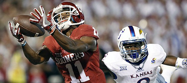 Oklahoma wide receiver Dede Westbrook (11) makes a catch for a touchdown ahead of Kansas cornerback Brandon Stewart (8) during the first half of an NCAA college football game in Norman, Okla., Saturday, Oct.29, 2016.