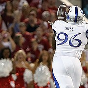 Kansas defensive tackle Daniel Wise (96) grabs a fumble by Oklahoma during the first half of an NCAA college football game in Norman, Okla., Saturday, Oct.29, 2016.