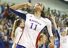 Kansas setter Ainise Havili (11) pumps her fist during Saturday's win against Texas. The Jayhawks beat the Longhorns in five sets.