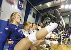 Kansas libero Cassie Wait (5) and the Jayhawks give a high leg kick while singing the Alma Mater after beating the Longhorns in five sets on Saturday, Oct. 29, 2016 at the Horejsi Center.
