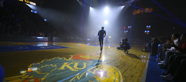 Kansas guard LaGerald Vick runs out to the court as the team is introduced during Late Night in the Phog on Saturday, Oct. 1, 2016 at Allen Fieldhouse.