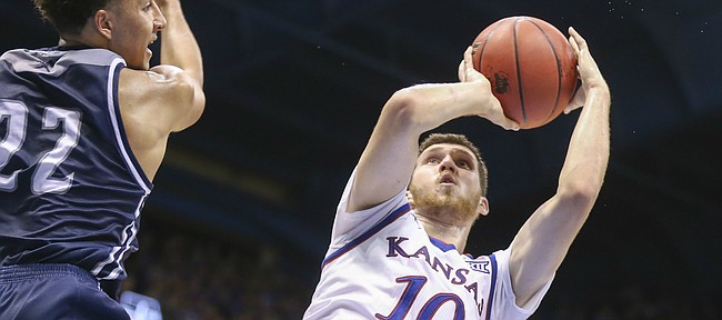 Kansas guard Sviatoslav Mykhailiuk (10) hangs for a shot against Washburn forward Brady Skeens (22) during the second half, Tuesday, Nov. 1, 2016 at Allen Fieldhouse.