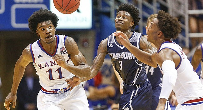 Kansas guard Josh Jackson (11) comes away with a steal from Washburn guard Randall Smith (3) during the first half, Tuesday, Nov. 1, 2016 at Allen Fieldhouse. At right is Kansas guard Devonte' Graham (4).
