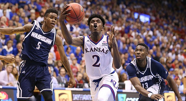Kansas guard Lagerald Vick (2) makes a move to the bucket between Washburn guard Javion Blake (5) and guard Tyas Martin (13) during the second half, Tuesday, Nov. 1, 2016 at Allen Fieldhouse.